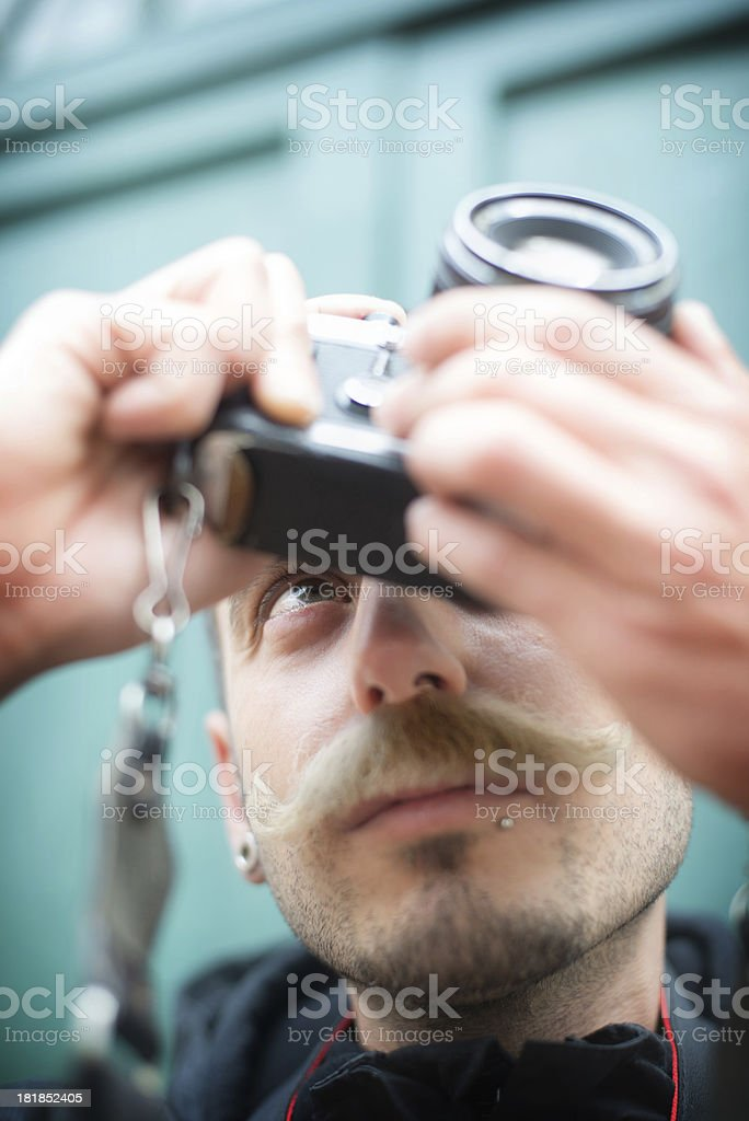 Vintage Photographer with Moustache Taking a Picture royalty-free stock photo