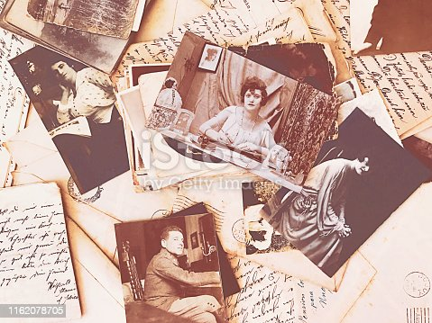 Top view photo of vintage letters and photos from the beginning of the 20th century.