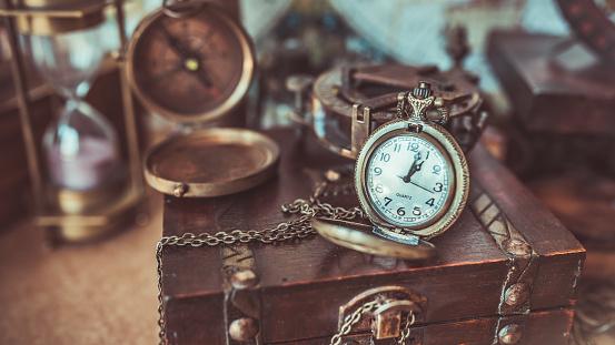 Compass on wood treasure chest