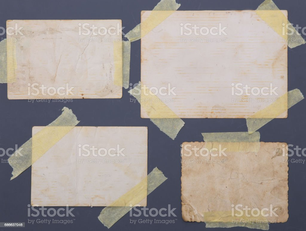 vintage photos taped on grey background royalty-free stock photo