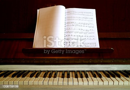 Vintage Piano with a Music Book