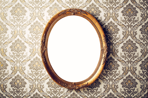 Vintage picture frame on baroque style wallpaper.