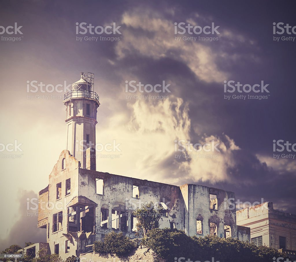 Vintage picture of dramatic rainy sky over Alcatraz Island in San...