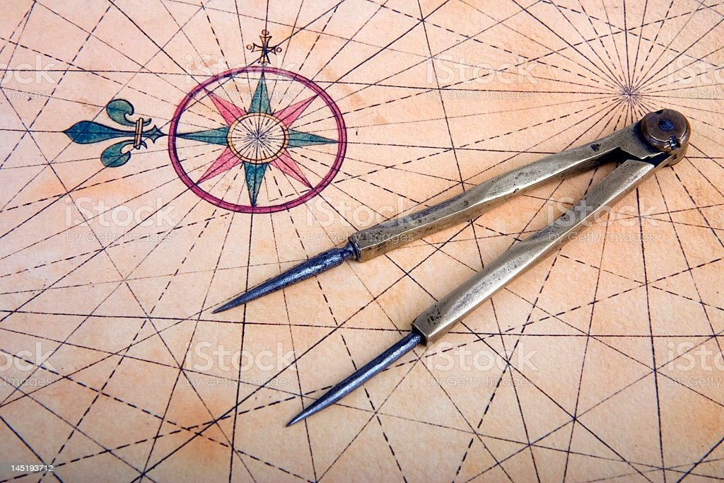 A vintage piece of paper and a compass stock photo