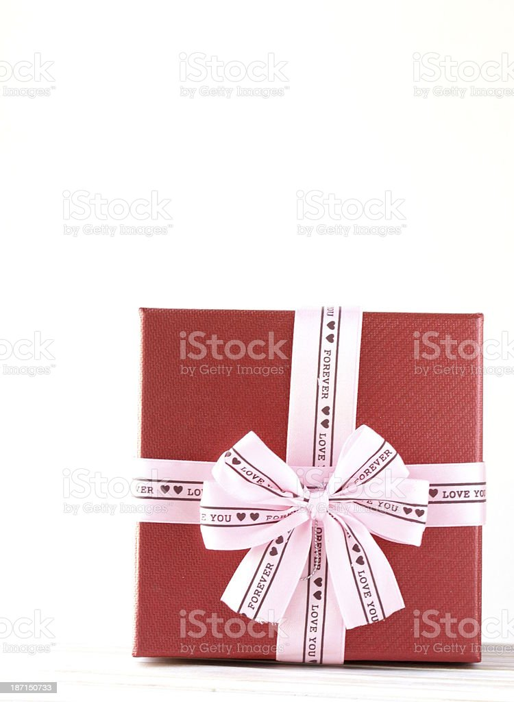 Vintage pink gift box with a bow on top royalty-free stock photo
