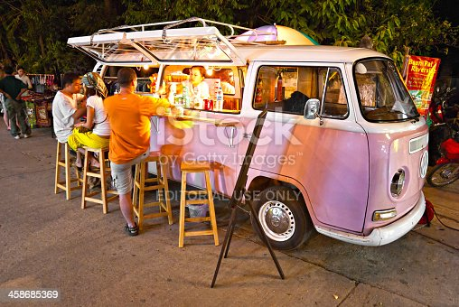 Chiang Mai, Thailand - November 05, 2011: A Vintage pink Volkswagen Bus transformed in a mobile bar for serving refreshing drink to tourists.