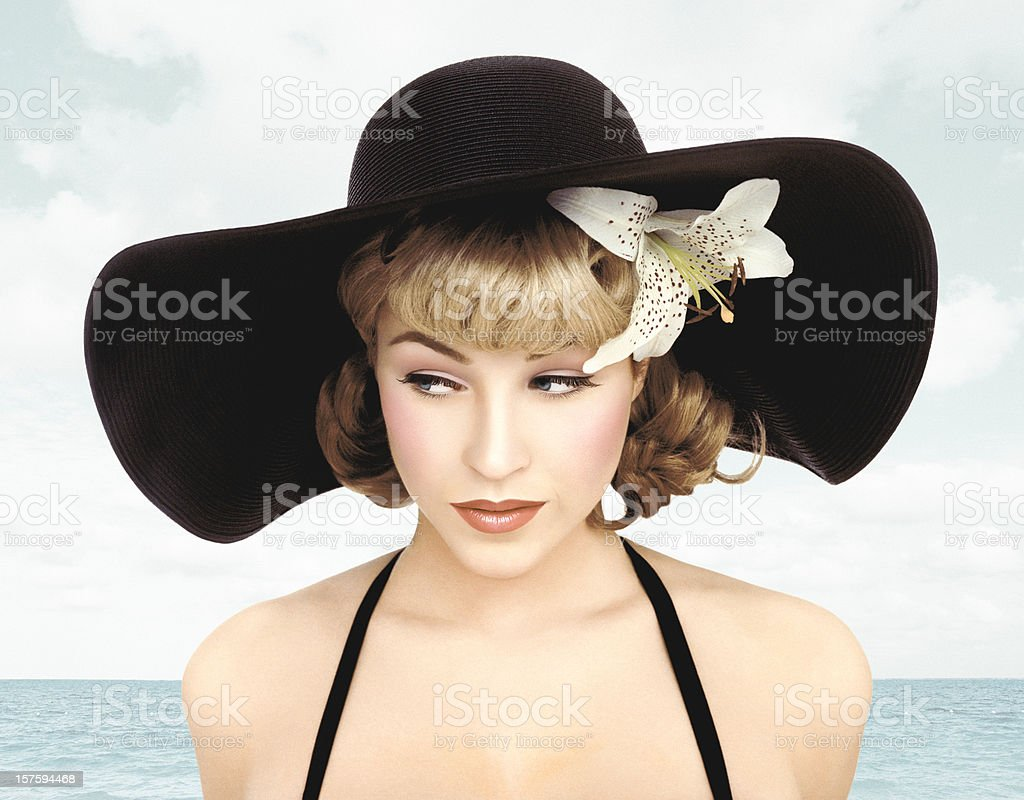Vintage Pin-up Girl Close-up Wearing A Hat On A Sea Background stock photo