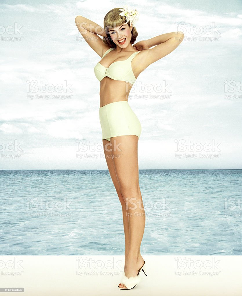 Vintage Pin-up Girl Wearing Bathing Suit At The Ocean stock photo