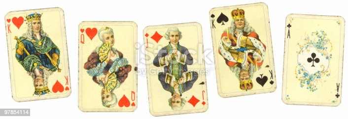 A scattered deck of antique playing cards