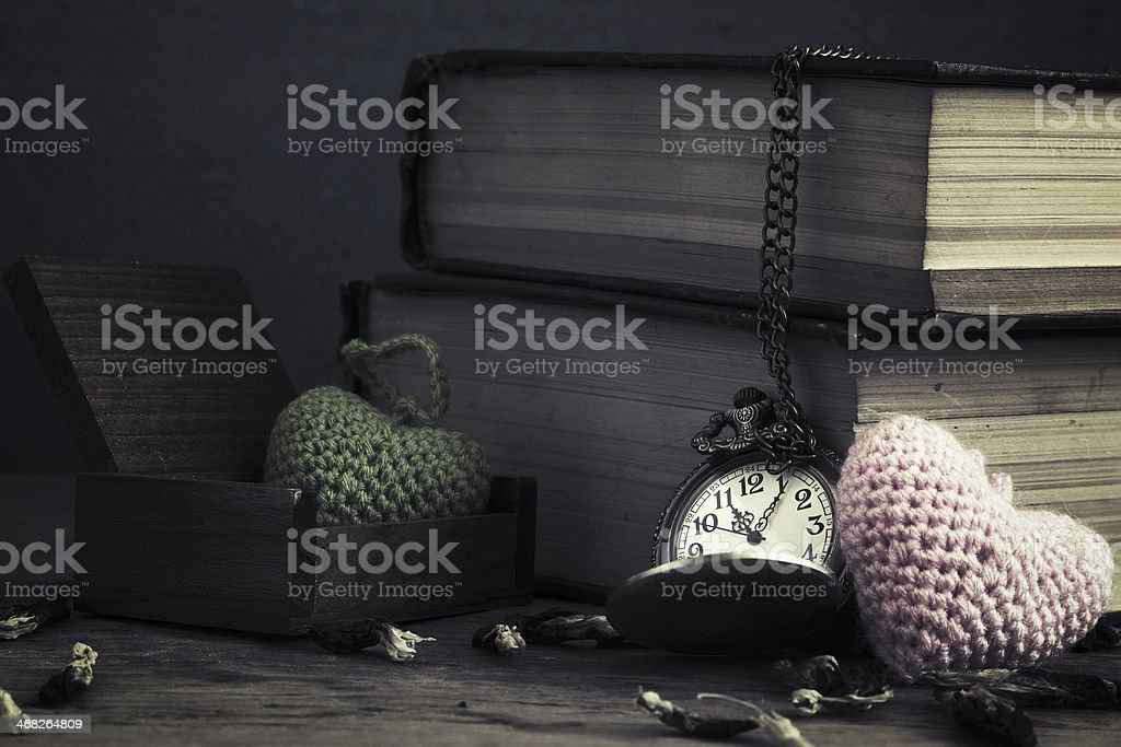 vintage pocket watch and old book stock photo