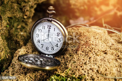 istock vintage pocket watch on stone 533978670