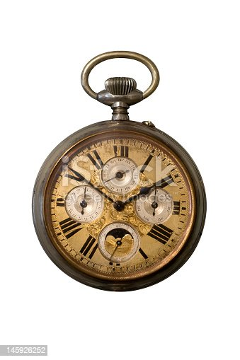 Old metal pocket watch isolated on a white background. Manufactured at the beginning of the 20th century.