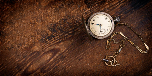 vintage pocket watch on wooden table - watch timepiece stock photos and pictures