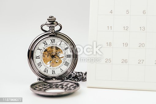istock Vintage pocket watch with white clean desktop calendar on white background using as time passing, time management, year change or deadline concept 1137968077