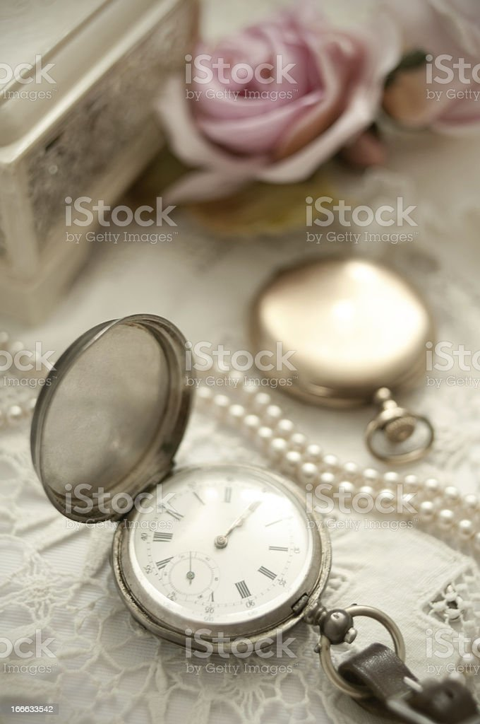 Vintage pocket watches and pearls on lace with rose royalty-free stock photo