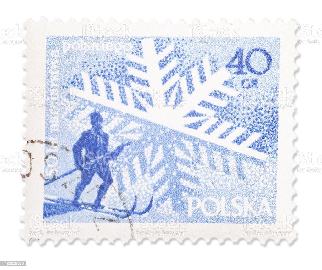 Vintage Polish stamp - Skier and snowflake royalty-free stock photo