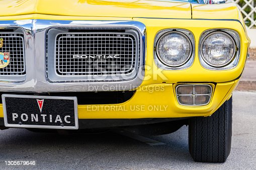 Miami, Florida USA - March 5, 2017: Close up view of the front end of a beautifully restored 1969 Pontiac Firebird convertible at a public car show.
