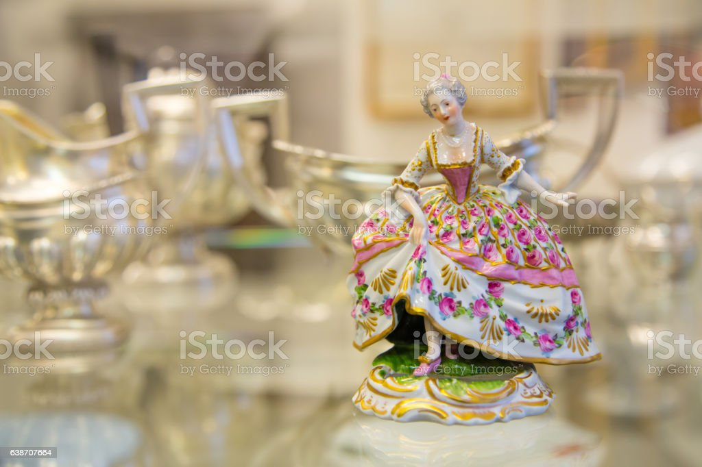 vintage porcelain doll in the blurry background stock photo