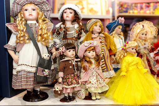 Vintage porcelain dolls found on the flea market, isolated.