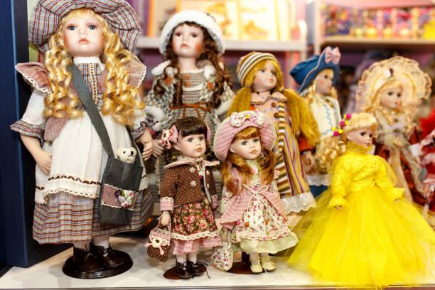 Vintage porcelain dolls found on the flea market, isolated stock photo