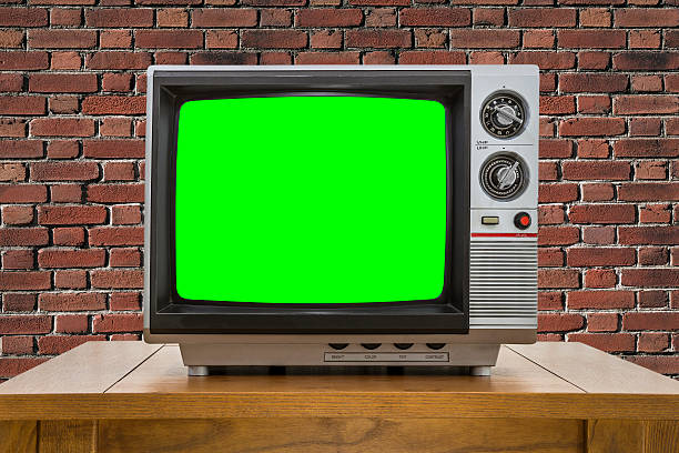 Vintage Portable Television with Brick Wall and Chroma Screen stock photo