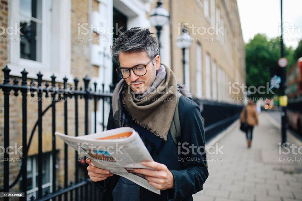 vintage portrait of a man reading newspapers in London downtown stock photo