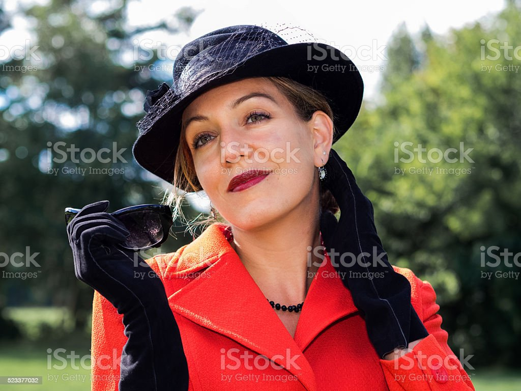 Vintage portrait of a young attractive woman wearing old fashion stock photo