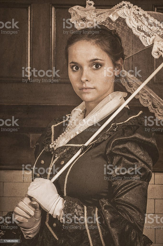 Vintage portrait of a young woman with parasol - II royalty-free stock photo