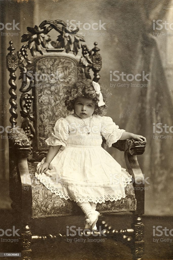 Vintage Portrait of Little Girl in Giant Chair royalty-free stock photo