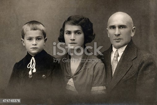 A vintage photo portrait from 1930 of Russian family.