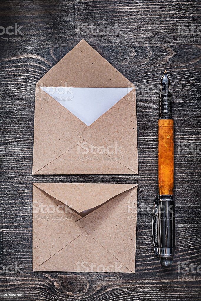 Vintage post envelopes letter fountain pen on wooden board royalty-free stock photo