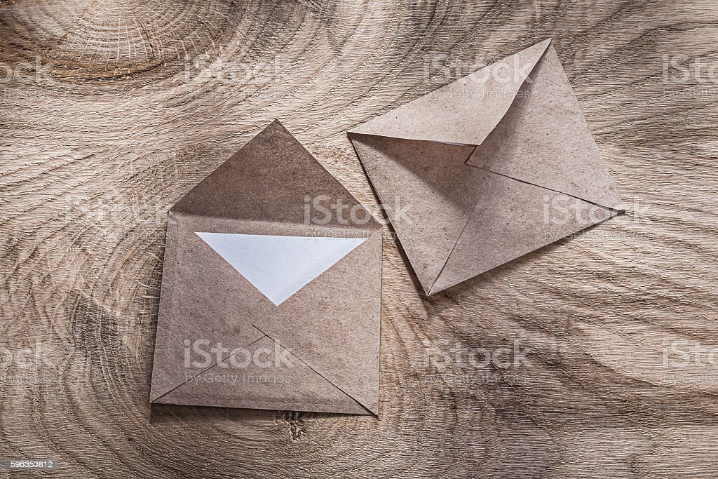 Vintage post envelopes on wooden board royalty-free stock photo