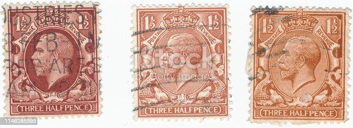 POLTAVA, UKRAINE - APRIL 24, 2019. Various vintage postage stamps printed in Great Britain 1912 shows , King George V