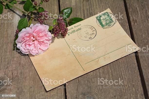 vintage postcard  is on wood with pink rose
