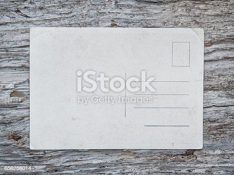 882302538istockphoto Vintage postcard on the old wood 656256014