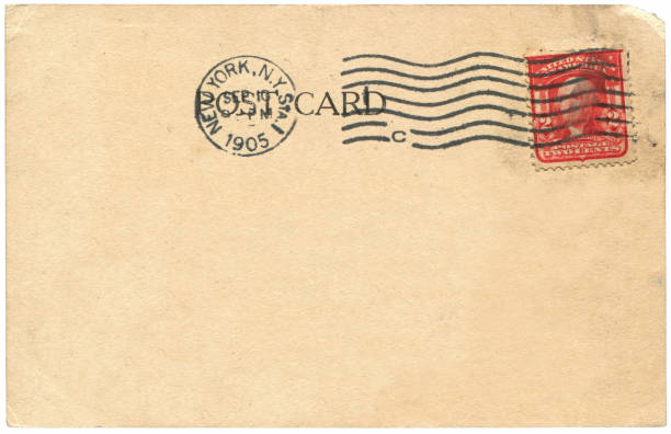 Vintage postcard sent from New York City in USA in early 1900s, with a 2 cent Washington stamp issued in 1903, a very good background for any usage of the historic postcard communications. stock photo