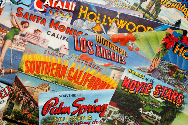 Vintage Postcards From Los Angeles Area San Diego, CA, USA - February 27, 2018: A close up of several vintage postcards from the 1930's, 1940's and 1950's representing various cities and areas in the greater Los Angeles area rest randomly on top of each other in a studio setting. Cities and areas represented include Catalina Island, Los Angeles,Santa Monica, Hollywood, Pasadena, and Palm Springs.  The postcards were a popular way for visitors and travelers to share their travel experiences with friends and family during the mid-20th century. hollywood california stock pictures, royalty-free photos & images
