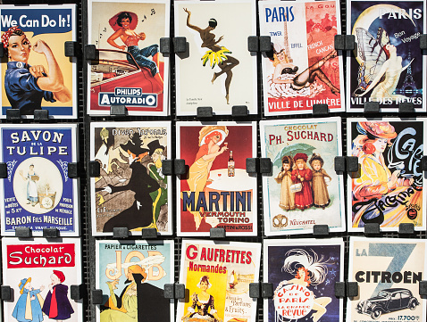Paris, France - April 27, 2016: Vintage posters and advertisements for sale by bookinist (Le Bouquinist) at a traditional bookstall near Seine River. The Bouquinistes sell their used and antiquarian books along the banks of the Seine allready for centuries.