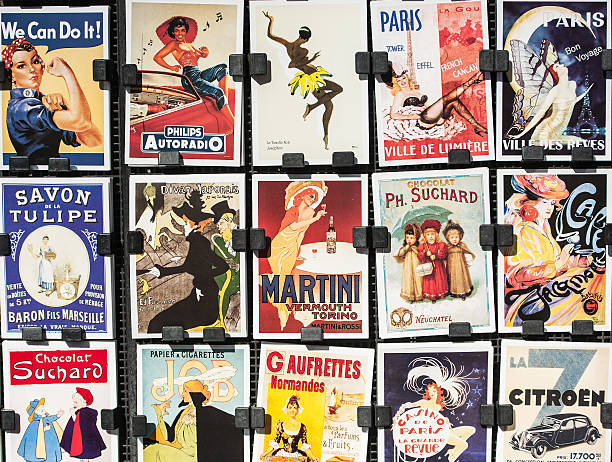 vintage posters and advertisements for sale at traditional bookstall, paris - vintage stock photos and pictures