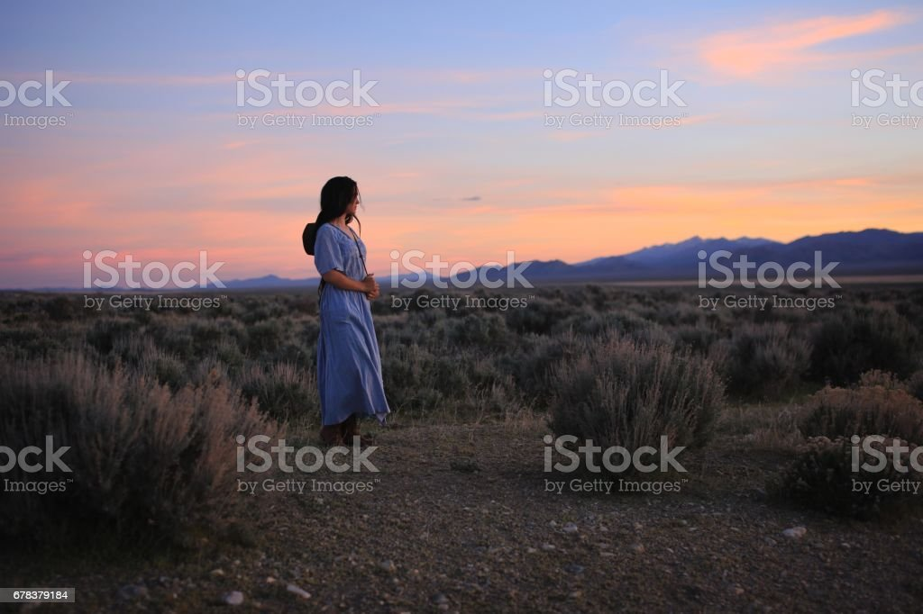 Vintage Prairie Girl in Nevada Western American Indian Cowgirl Sunset Long Hair stock photo