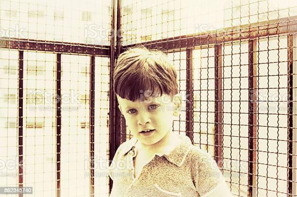 Vintage pre-school boy portrait in a balcony