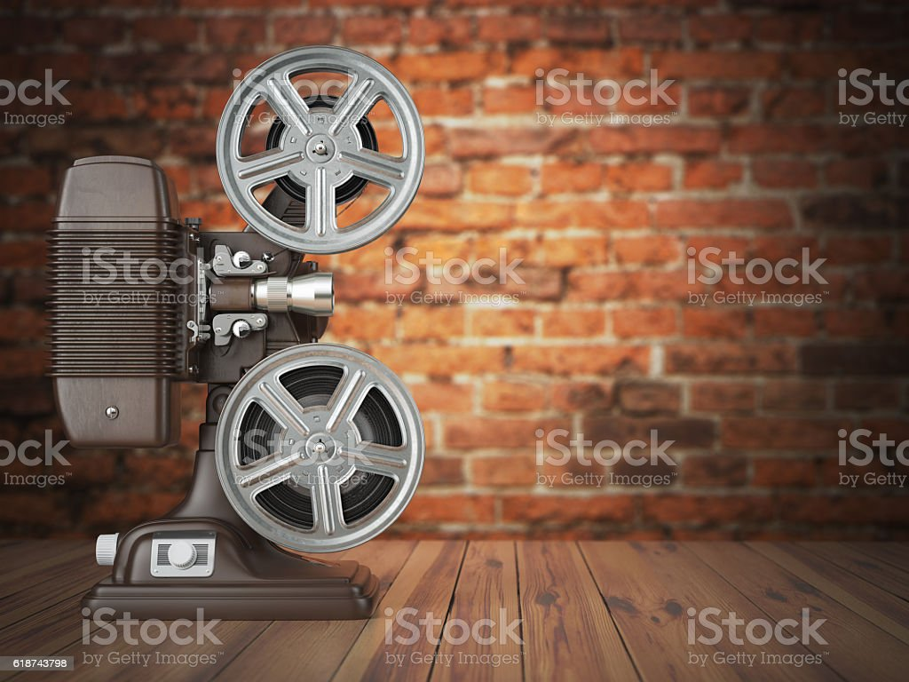Vintage projector on the bricks background. Cinema, movie or vid stock photo