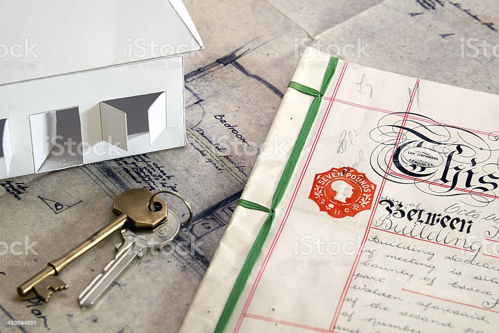 Vintage property deeds and plans with keys stock photo