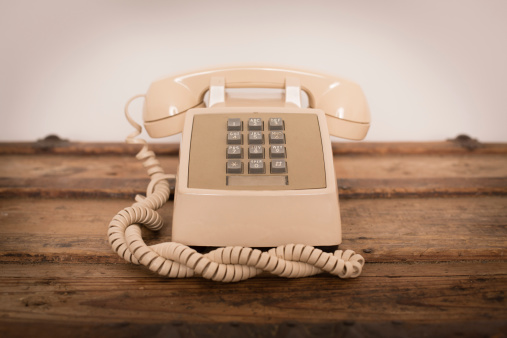 Vintage Push Button Telephone On Old Wood Trunk Stock Photo - Download Image Now