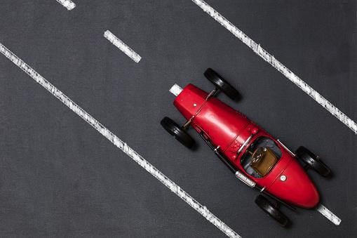 Vintage race car isolated on white background