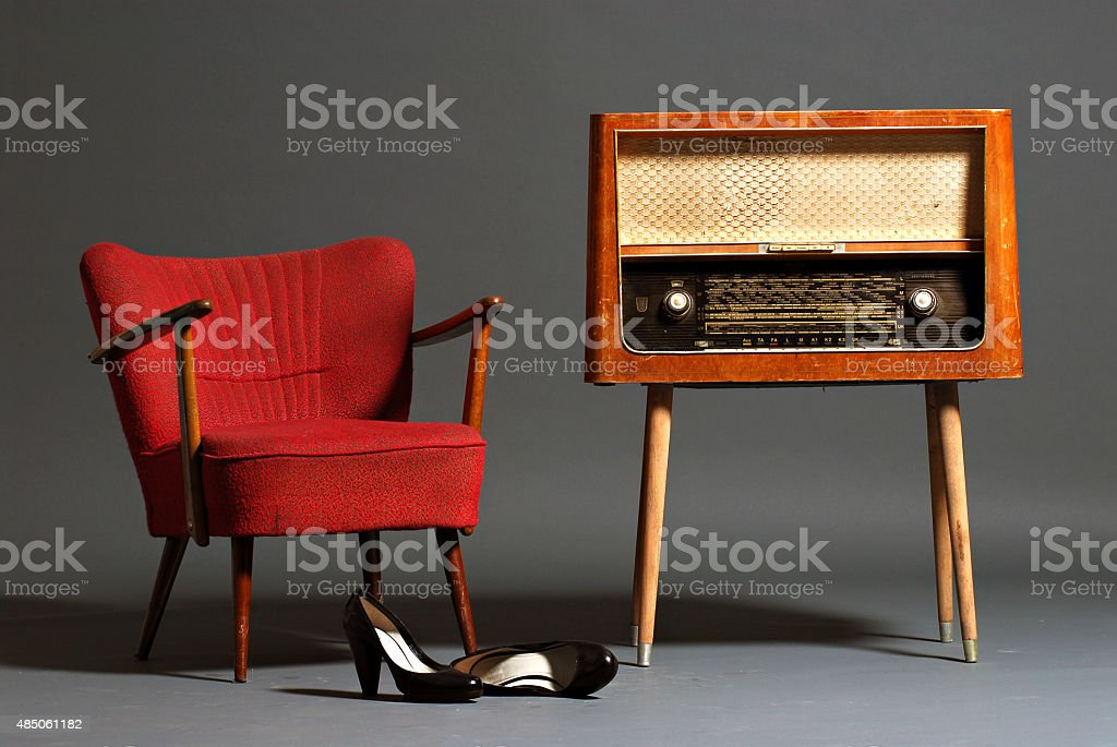 Vintage radio and armchair stock photo