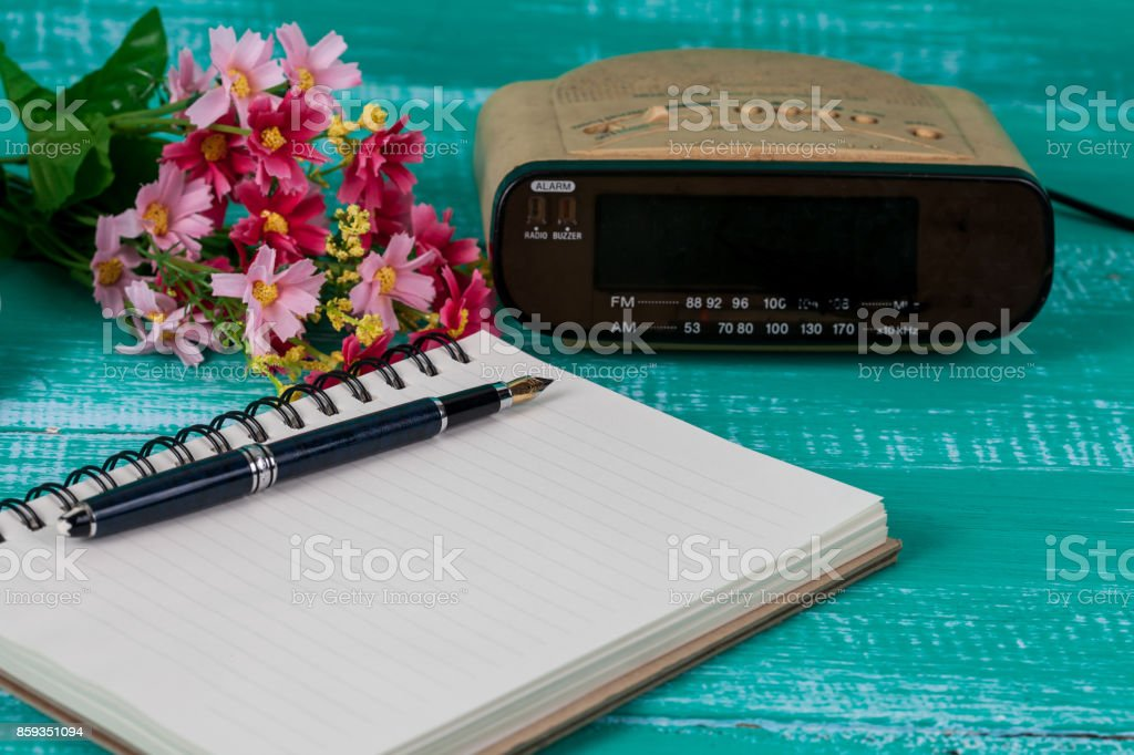 vintage radio with book note on wood background stock photo