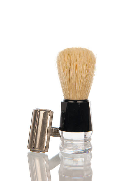 Vintage razor with shaving brush Traditional steel razor with hairy shaving brush isolated in white shaving brush shaving cream razor old fashioned stock pictures, royalty-free photos & images