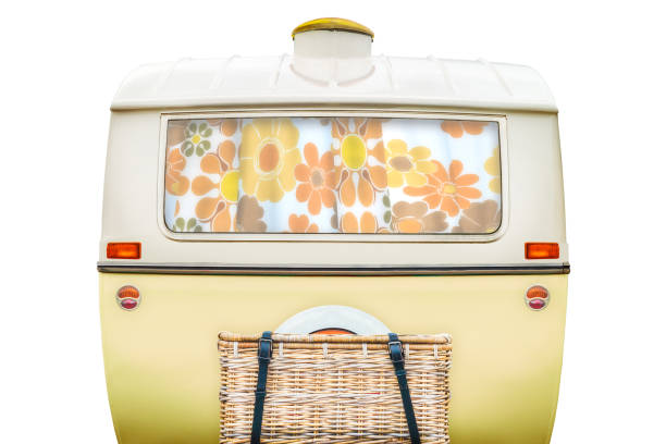 Vintage rear of a caravan in two tone yellow and white isolated on white stock photo