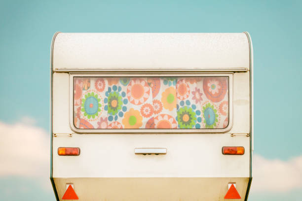 Vintage rear of a caravan with seventies flower curtains stock photo